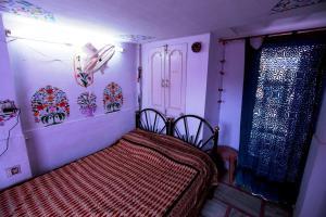 Ein Bett oder Betten in einem Zimmer der Unterkunft Shanti House