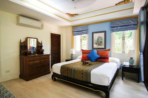 A bed or beds in a room at Rabbit Resort Pattaya
