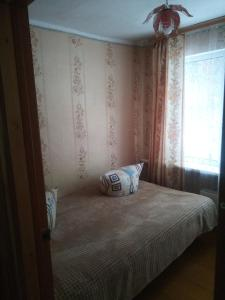 A bed or beds in a room at Guesthouse V Sosnovom Boru