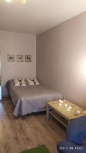 A bed or beds in a room at Bondareva Street Apartment