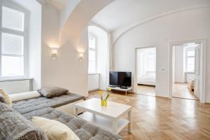 A seating area at Vienna-apartment-one Schmidgasse