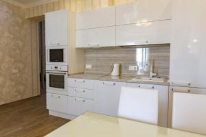 A kitchen or kitchenette at Apartment Ideal House