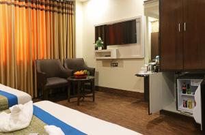 A television and/or entertainment center at Hotel Mannat international by Mannat