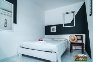Cama ou camas em um quarto em Pousada Cambará