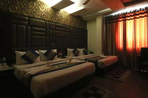 A seating area at Hotel Mannat international by Mannat