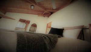 A bed or beds in a room at Unlax @ Hunter Valley