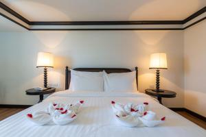 Ein Bett oder Betten in einem Zimmer der Unterkunft Mora Boutique Hotel