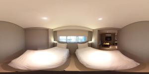 A bed or beds in a room at 甲山林101行旅