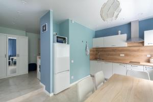 A kitchen or kitchenette at New in the Center
