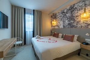 Un ou plusieurs lits dans un hébergement de l'établissement Brit Hotel Ker Lann Aeroport