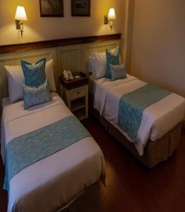 A bed or beds in a room at Alto Calafate Hotel