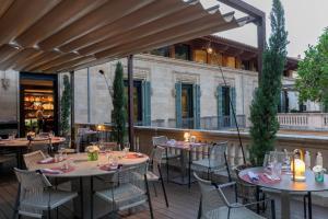 Ein Restaurant oder anderes Speiselokal in der Unterkunft Boutique Hotel Can Alomar