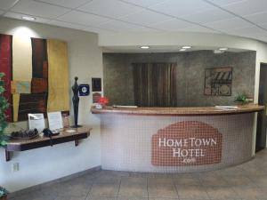The lobby or reception area at HomeTown Hotel