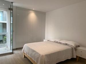 A bed or beds in a room at Vive - Descansa - Disfruta