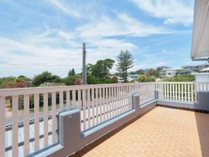 A balcony or terrace at The Loft @ Fingal Bay