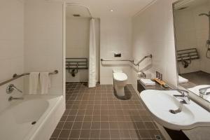 A bathroom at Novotel Melbourne On Collins