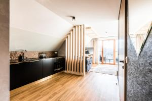 A kitchen or kitchenette at Aparthotel Prestige