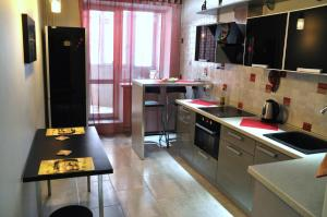 A kitchen or kitchenette at International Apartment