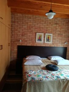 A bed or beds in a room at Eddies Self Catering or B&B