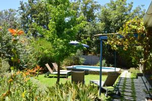 The swimming pool at or near Blaauw Cottage