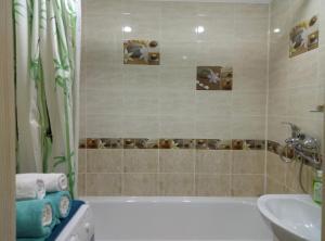 A bathroom at 1 k apartment on chetaeva 22