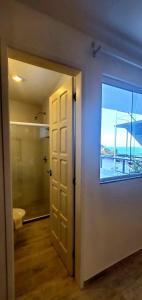 Um banheiro em Pousada Ilha da Saudade
