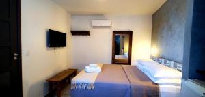 Cama ou camas em um quarto em Pousada Ilha da Saudade
