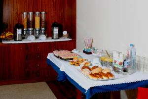 Breakfast options available to guests at Hotel Paulo VI