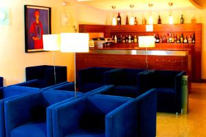 The lounge or bar area at Hotel Paulo VI