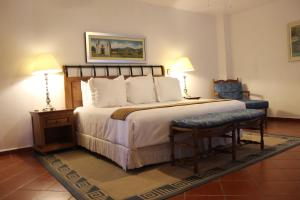 A bed or beds in a room at Hotel Boutique Casa de Campo
