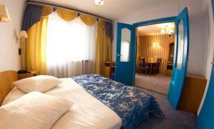 Кровать или кровати в номере Гостиничный Комплекс Лучеса