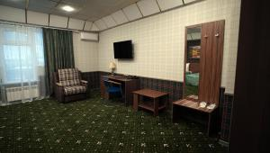 A television and/or entertainment center at Hotel Astral Complex A