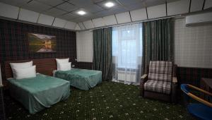 A bed or beds in a room at Hotel Astral Complex A