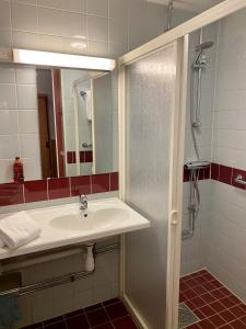 Ett badrum på Hotell Höga Kusten