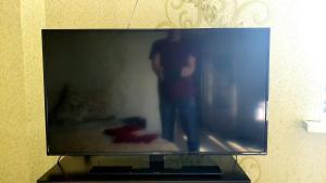 Телевизор и/или развлекательный центр в Apartamenty RoomOnDay Sharapovskiy 2