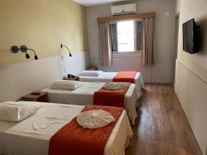 Cama ou camas em um quarto em Hotel Cisne