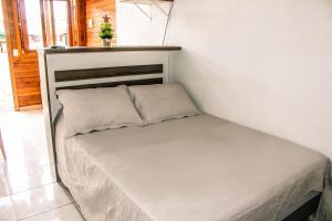 Cama ou camas em um quarto em Chales Dos Alpes