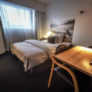 A bed or beds in a room at Hotel Sisimiut