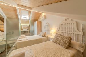 """Cama o camas de una habitación en Apartamentos """"Quotidianum"""""""