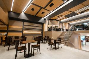 Un restaurant u otro lugar para comer en Hotel Spa Republica