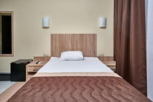 A bed or beds in a room at Park Hotel Akter Ruza