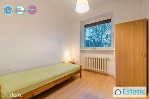 A bed or beds in a room at Zalewski Team - Kwatera Pracownicza Gdańsk ul. Szczecińska