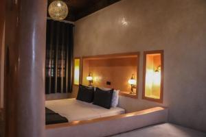 Cama o camas de una habitación en Nomad Palace