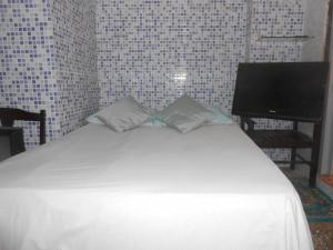 A bed or beds in a room at A meson Suites