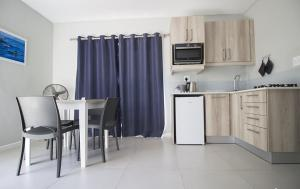 A kitchen or kitchenette at Kleinmond Lodge