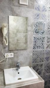 Ванная комната в Guest House Shafran