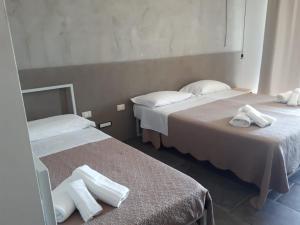 Letto o letti in una camera di Agua Green Resort