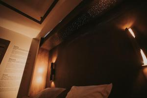 A bed or beds in a room at La Trobada Hotel Boutique