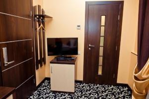Телевизор и/или развлекательный центр в Lite Hotel Волгоград