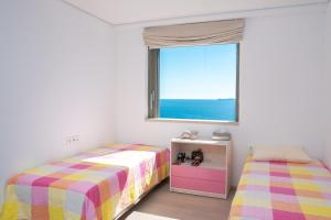 A bed or beds in a room at Sirene Blue Resort